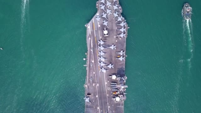 Top View Aircraft Carrier in international waters Top View Aircraft Carrier in international waters landing touching down stock videos & royalty-free footage