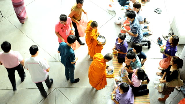 top view: Buddhist monks collecting alms and offerings in new year event video