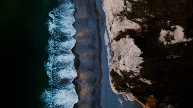 Top view, drone flying directly above famous white cliffs at Normandy sea shore, calm azure waves and alabaster rocks. Top view, drone flying directly above famous white cliffs at Normandy sea shore, calm azure waves and alabaster rocks. Beautiful aerial background flyover shot, idyllic rocky coastline at Etretat. normandy stock videos & royalty-free footage