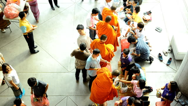 top view: group of Buddhist monks collecting alms and offerings video