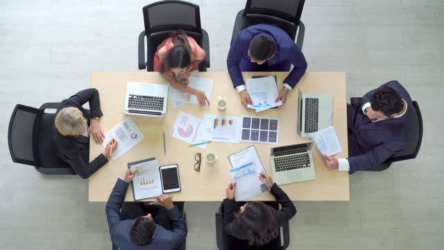 4K Top view group of Professional diversity businessman and businesswoman colleague teamwork meeting in office conference room to discussion and brainstorm business strategy for success business project