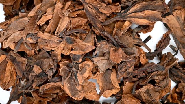 top view herb medicine JiDanHua or Plumeriae Acutifoliae Flos or Mexican Frangipani Flower rotating - vídeo