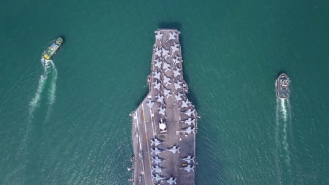 Top view Nuclear power aircraft carrier or Battleship Navy Top view Nuclear power aircraft carrier or Battleship Navy landing touching down stock videos & royalty-free footage