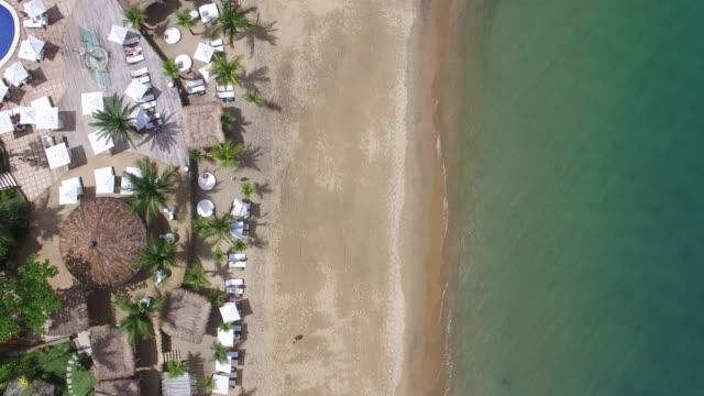 vídeos de stock e filmes b-roll de top view of a costal beach - ibiza