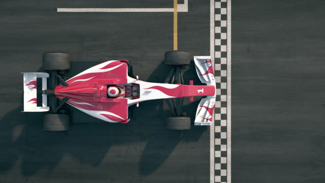top view of a formula one race car driving over finish line in slow motion - race stock videos & royalty-free footage