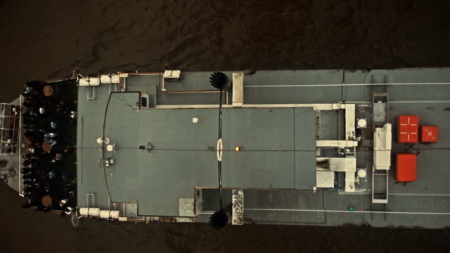 Top view of a large paddle steamer vessel passing under Tower Bridge in London, UK with lifts closing video