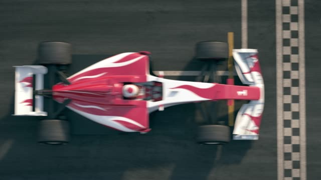 vídeos y material grabado en eventos de stock de vista superior de una fórmula de un coche de carreras que conduce sobre la línea de meta - meta