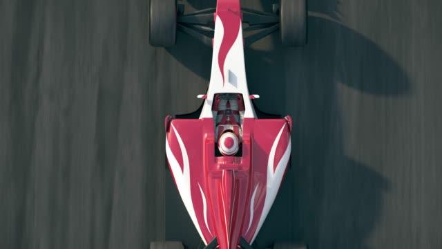 결승 선을 통해 운전 하는 포뮬러 원 레이스 자동차의 평면도 - formula 1 스톡 비디오 및 b-롤 화면