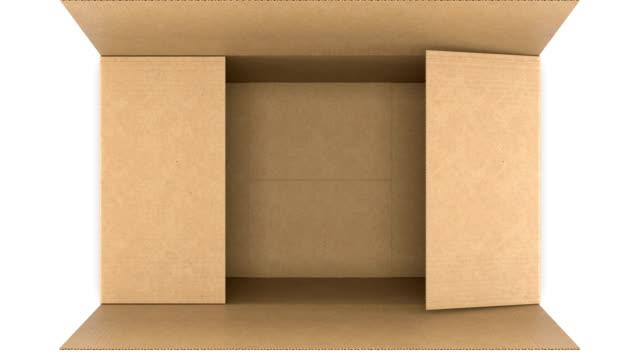 top-ansicht von karton-box öffnen und schließen auf weißen und schwarzen hintergründen mit alpha-maske nahtlos. looped 3d animation der aufbewahrungsbox. lieferkonzept. - schachtel stock-videos und b-roll-filmmaterial