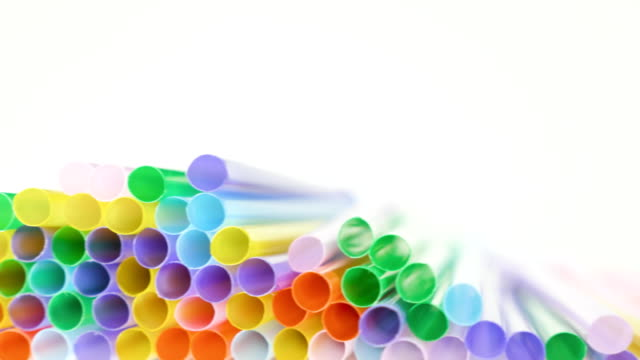 Top view of colorful straw on the rotation table Top view of colorful straw on the rotation table. straw stock videos & royalty-free footage