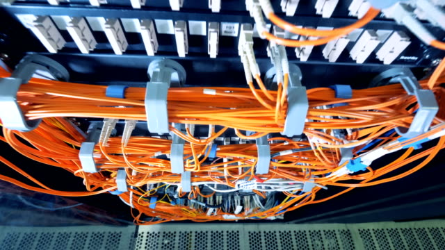 Top view of data servers connected by orange wires Top view of data servers connected by orange wires. 4K mainframe stock videos & royalty-free footage
