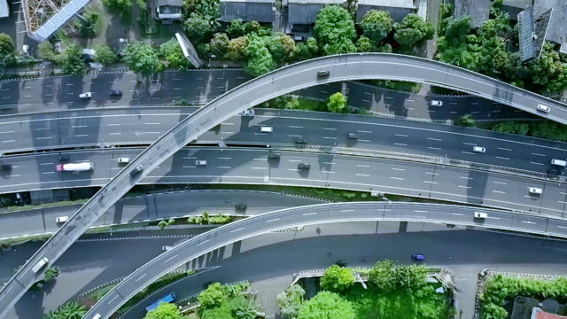 Top view of flyover with city park Aerial view of Toman flyover in Jakarta, Indonesia flimed in 4K from a drone jakarta stock videos & royalty-free footage
