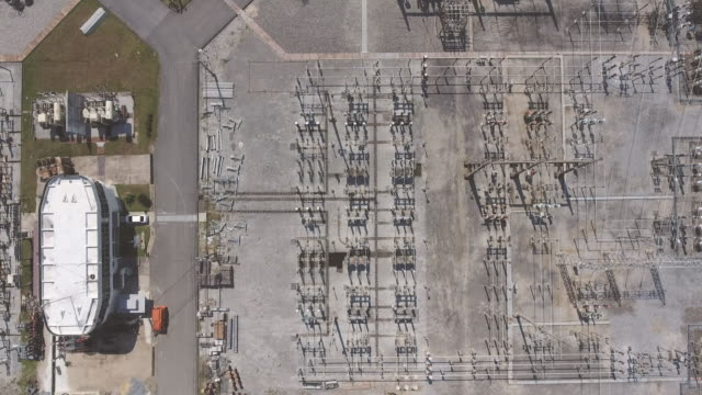 top view of high voltage power station, electrical substation, aerial view - sottostazione elettrica video stock e b–roll