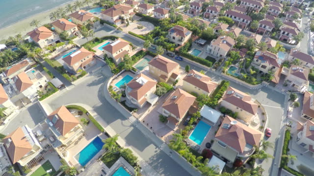 Top view of houses with swimming pools for rent. Vacation video