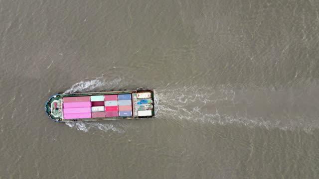 vídeos de stock e filmes b-roll de top view of international port with crane loading containers in import export business logistics. - transatlântico