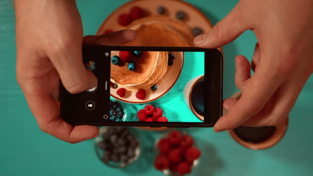 top view of male hands taking photos - miele dolci video stock e b–roll