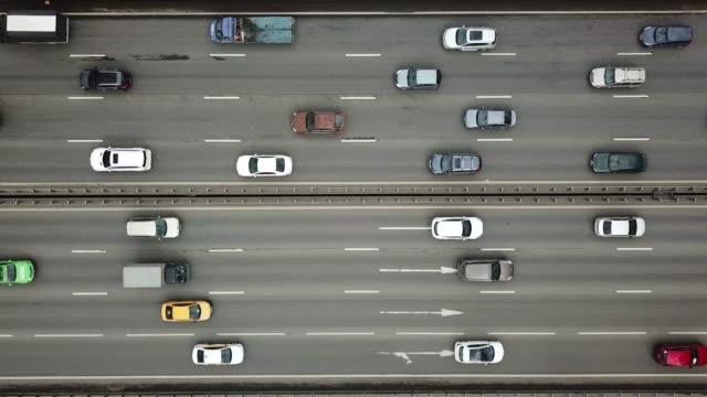 top view of moving cars on highway - traffic filmów i materiałów b-roll