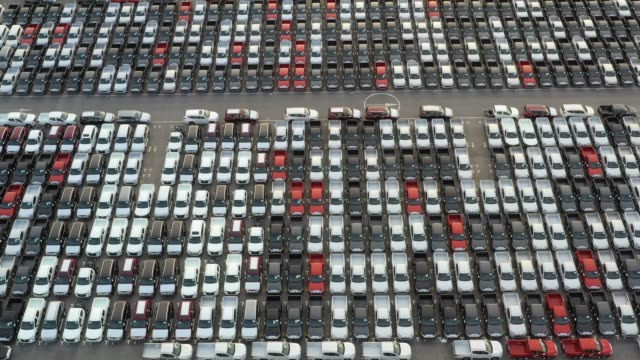 Top view of new cars lined up outside an automobile factory for import & export. Top view of new cars lined up outside an automobile factory for import & export. car rental stock videos & royalty-free footage
