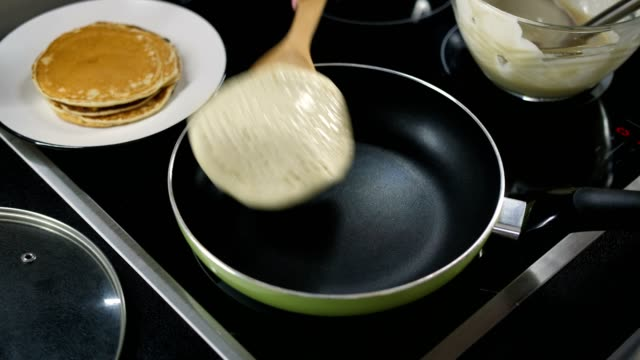 top view of pancake flipped on frying pan - pancake video stock e b–roll