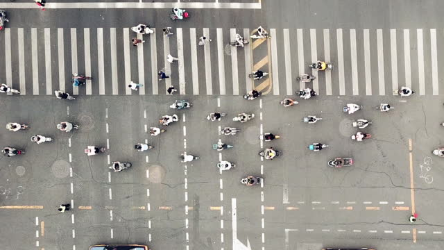 Top View of Pedestrians Walking across with Crowded Traffic