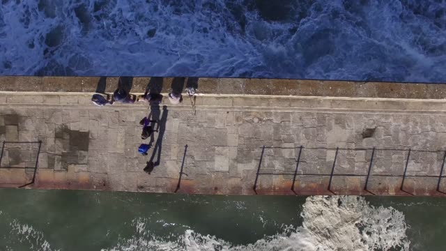 Top View of People Fishing in a Harbour video
