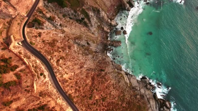 Top view of road at Chapmans Peak Drive Chapmans Peak Drive near Cape Town, South Africa. Top view of road going through beautiful landscape. Road bending along the ocean. cape town stock videos & royalty-free footage
