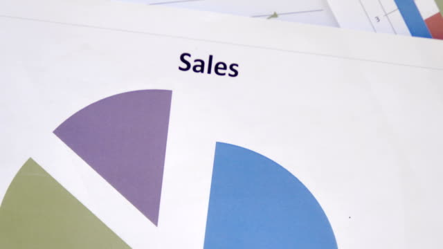 top view of sales chart on desk - servizi video stock e b–roll