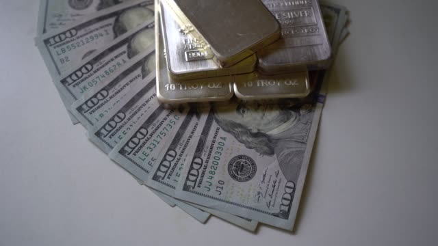 Top View of Silver Bars on Top of Hundred Dollar Bills Zooming In Top View of Silver Bars on Top of Hundred Dollar Bills Zooming In gold bars stock videos & royalty-free footage