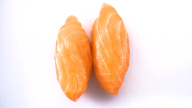 Top view of spinning two salmon sushi.