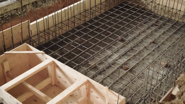 top view of the process of the formwork of space, builders are engaged in the construction of a structure of reinforced concrete