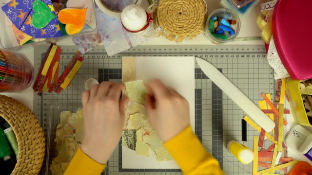 top view of the work of craftswoman. time lapse of scrapbooking process. - prodotto d'artigianato video stock e b–roll