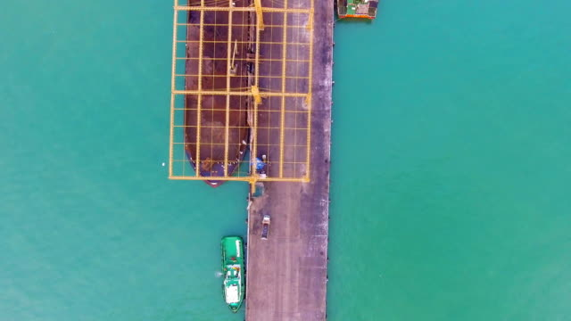 Top view of transport ship on dock in sea video