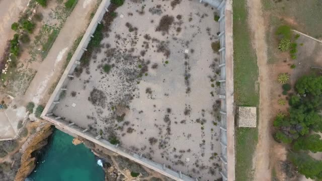 Top view of view of the concrete walls of the military Fort on the beach in Tarragona, Spain