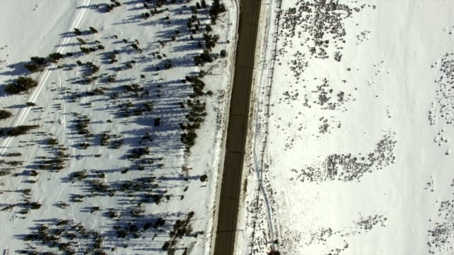 Top view of winter mountain road and ranch video