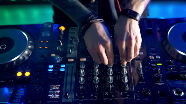 A top view on a DJ mixer in use at a party. video