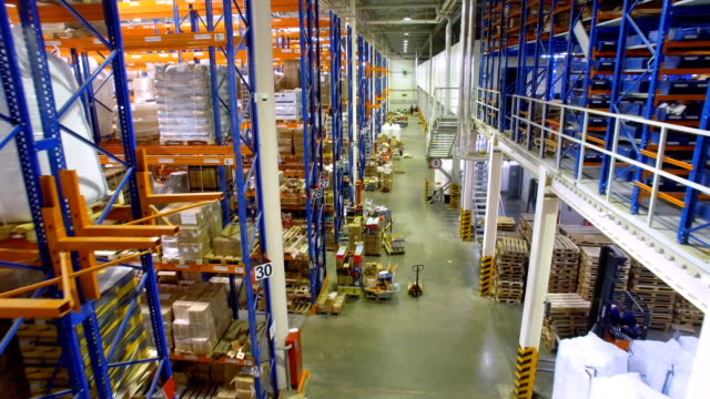a top view on a warehouse building with racks and loading area. - alto video stock e b–roll