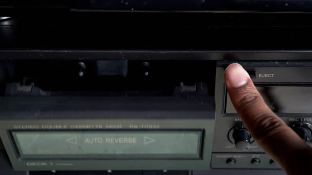 top view: opening cassette  stereo player - mangianastri video stock e b–roll