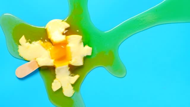 top view pineapple shape popsicle melting timelapse on blue background - vídeo