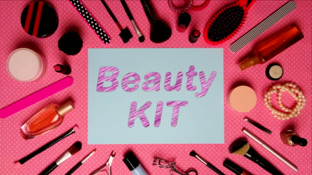 top view stop motion on the theme of women's makeup accessories with text announcement beauty kit - аксессуар для волос стоковые видео и кадры b-roll
