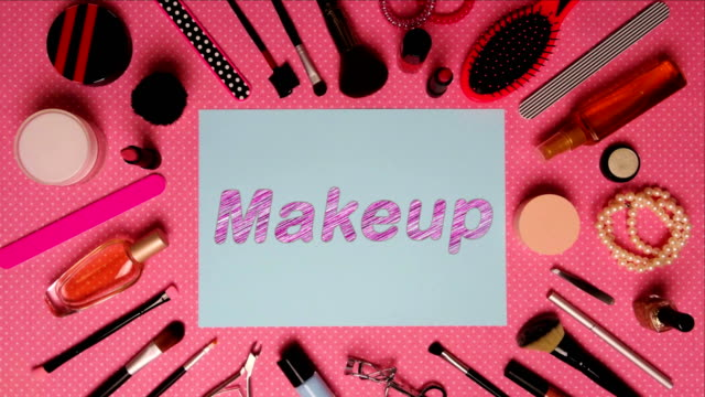 Top view stop motion on the theme of women's makeup accessories with text announcement Makeup