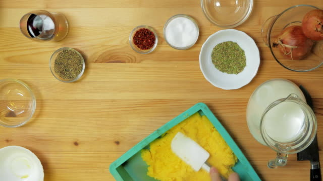 Top view. The man cooked polenta and spread it in the form of a neat bar on the kitchen table Top view. The man cooked polenta and spread it in the form of a neat bar on the kitchen table. table top view stock videos & royalty-free footage