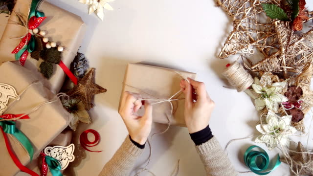 Top view woman wrapping christmas presents video