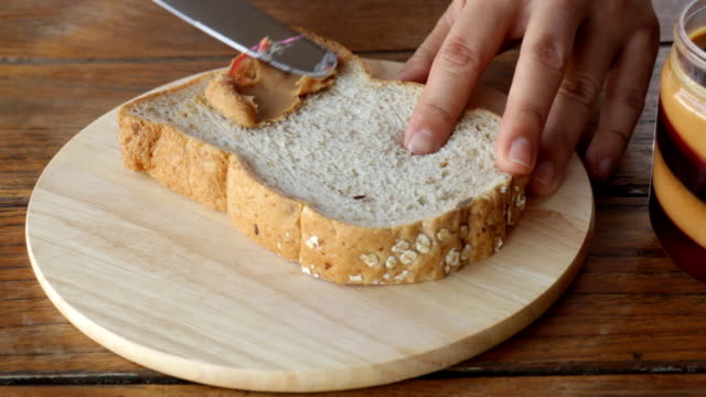 Topping whole wheat bread with peanut butter video