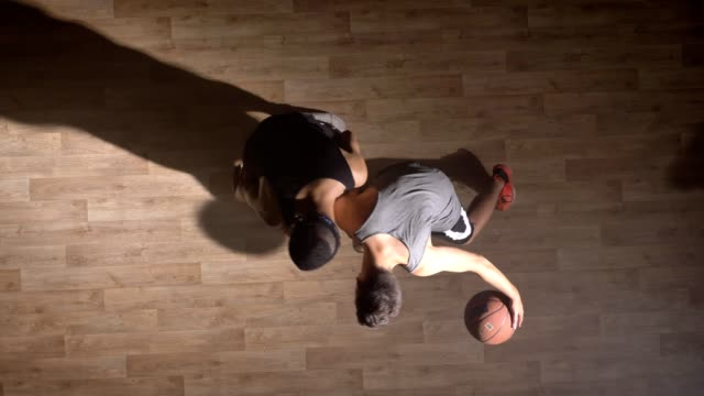 topshot, two friends playing basketball, player pushing another player and helping him to stand up - taking a shot sport stock videos & royalty-free footage