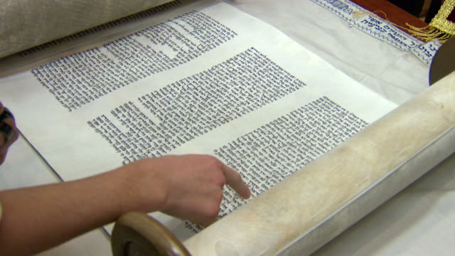 Torah Scroll Open and Reading A Torah scroll representing the five books of the Bible being read in a synagogue old testament stock videos & royalty-free footage