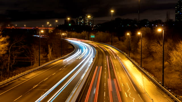 Toronto city rush hour traffic at night on curvy road timelapse video