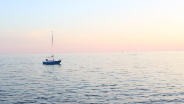 Toronto, ON, Canada - September 23, 2017 - short video of sunset on Lake Ontario with sailboat speedboats and jetskies video