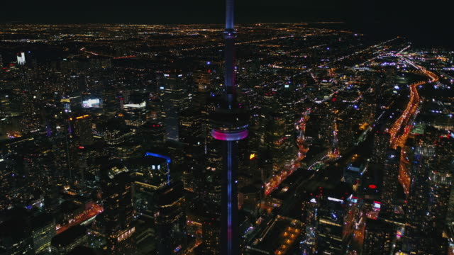 Toronto Ontario Aerial v73 Panning birdseye cityscape at night with CN Tower light show - October 2017