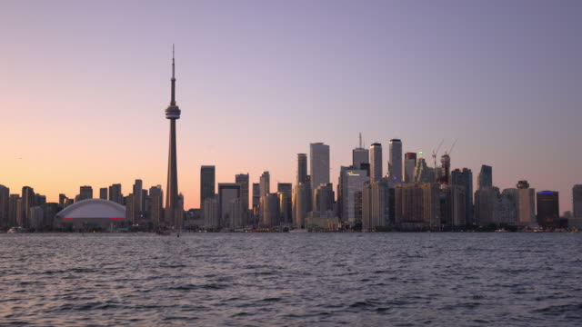 Toronto Skyline at twilight in Ontario Canada Toronto Skyline at twilight in Ontario, Canada ontario canada stock videos & royalty-free footage