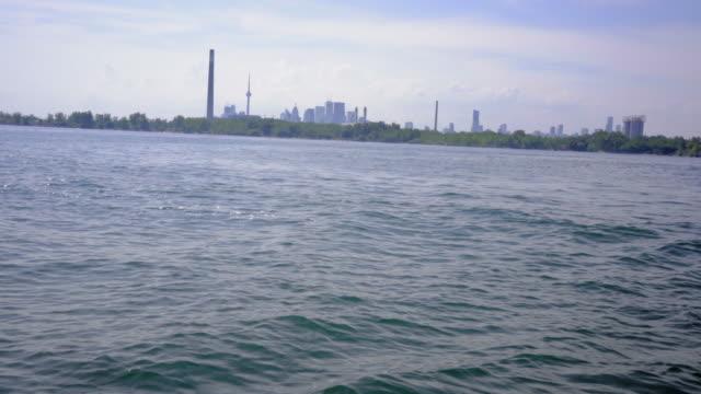 toronto skyline over the lake ontatio leasure in summer sunny video